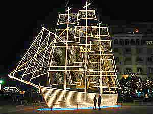 every december greeces second city thessaloniki erects a huge illuminated metal structure in the shape of a three mast ship next to the christmas tree - Greek Christmas Decorations